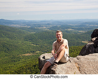 Hiker overlooking Shenandoah valley