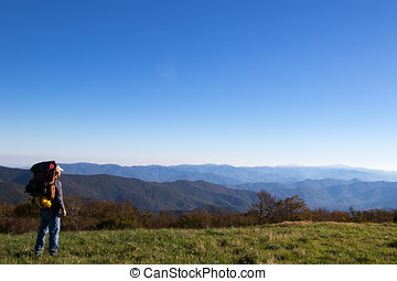 Hiker overlooking the appalachian mountains stretching into...