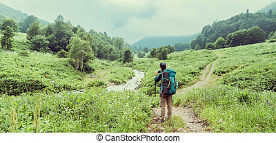 Hiker photographing the nature
