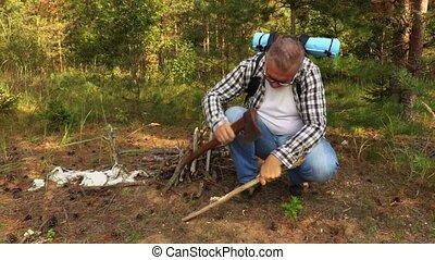 Hiker prepares the fire site
