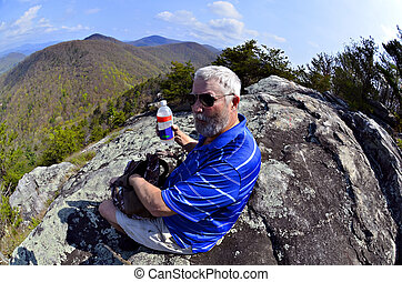 Hiker Resting and Having a Snack
