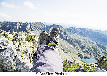 Hiker resting on top of the mountain