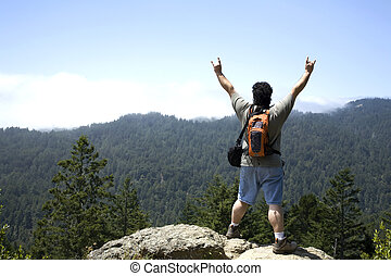 Hiker Shows Sign of Victory on Top of Mountain Peak at Muir ...