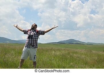 Hiker Spread His Arms to the Sun