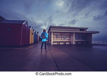 Hiker standing on the promenade near water