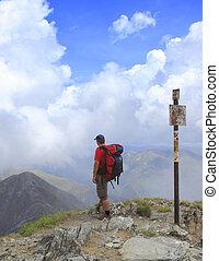 Hiker - Man scrutinizing the horizon in mountains.