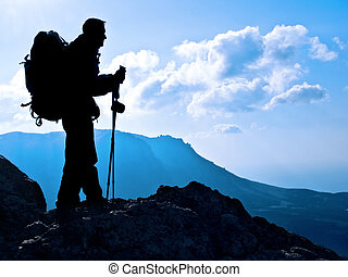 hiker - Hiker on top, silhouetted in high mountains