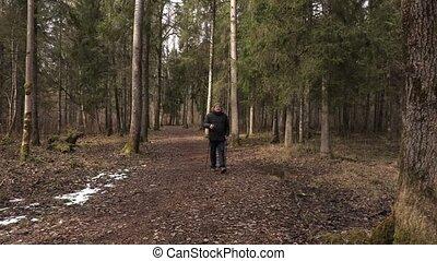 Hiker take break near tree