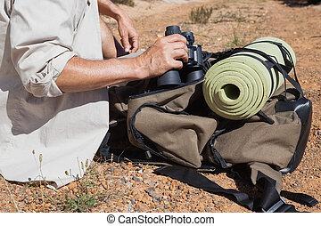 Hiker taking a break on country trail
