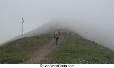 Hiker traveling in Alps. Alpine landskape background. Jungfrau, Bernese highland. Sport, tourism, journey and hiking concept.