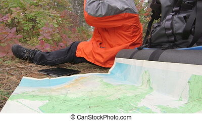 Hiker using digital tablet - Hiker looking for route on ...