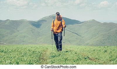 Hiker walking in mountains