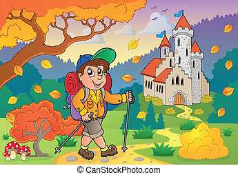 Hiker walking on path near castle