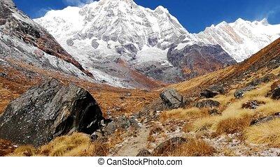 Hiker walking on trekking trail to Annapurna Base Camp,...