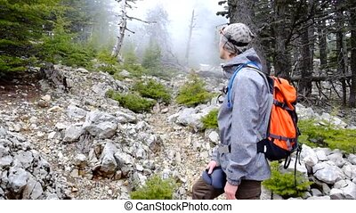Hiker walking outdoors wearing hiker backpacks. - Hiker...