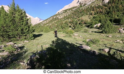 hiker walking through valley