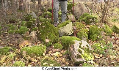 Hiker with hiking poles in rocky area