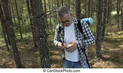Hiker with knife , cleans mushroom
