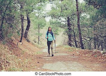 Hiker with trekking poles outdoor