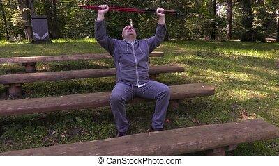 Hiker with walking sticks take