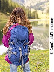 Hiker woman enjoying the lake view