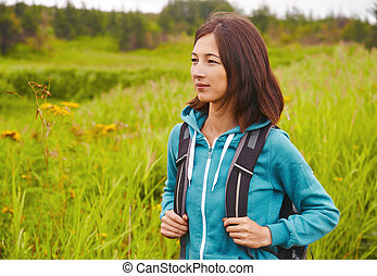 Hiker woman in summer