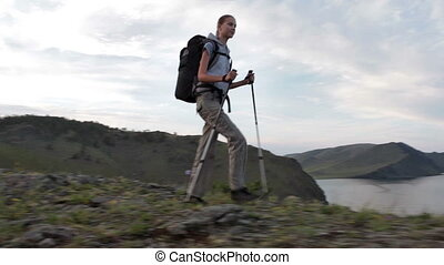 Hiker woman is walking mountain,