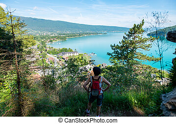 hiker woman looking at lake of Annecy in french alps