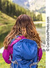 Hiker woman watching the lake