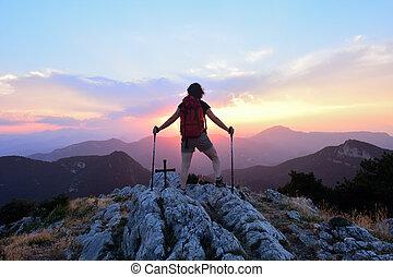 Hiker woman watching the sunset