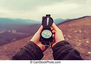 Hiker woman with a compass in the mountains - Hiker woman ...