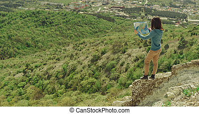Hiker woman with a map outdoor