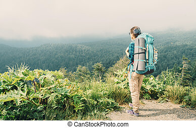 Hiker young woman with backpack