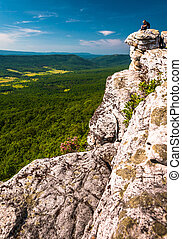 Hikers and view from a cliff on Big Schloss, in George Washington National Forest, VA.