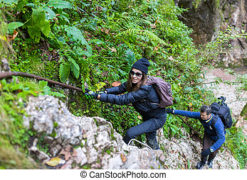 Hikers climbing on mountain wall