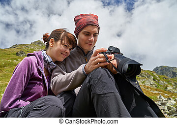 Hikers looking at their photos on camera