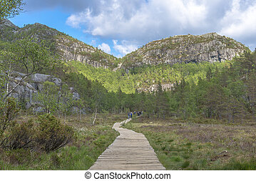 Hikers returning from Pulpit Rock in Norway