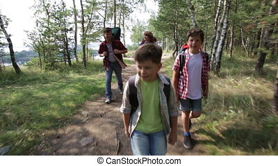 Hikers - Dynamic video of hiking family following the path...