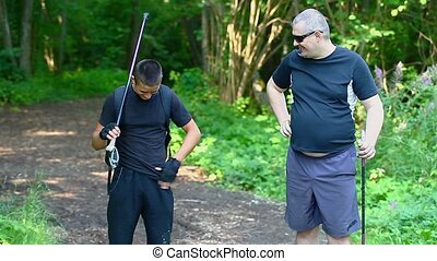 Hikers with six pack and overweight in forest