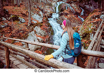 Hiking a gorge in the mountains during fall