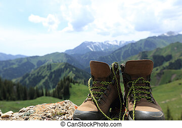 hiking boots on mountain peak