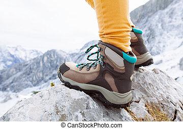 Hiking boots on mountain rocks