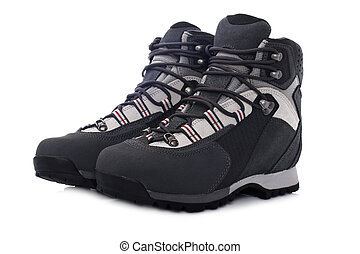 Hiking boots - A pair of hiking boots with soft shadow on...