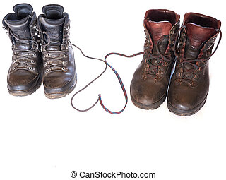 Hiking boots with shoe laces forming a heart