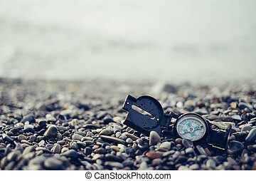 Hiking compass on coast