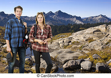 Hiking couple on a nature trail - Young couple, hiking along...