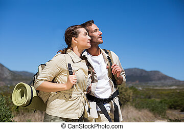 Hiking couple standing and looking