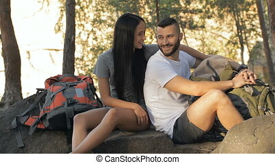 Hiking couple talking at the forest