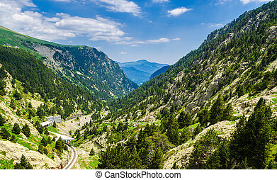 Hiking down the Cremallera de Nuria railway in Vall de Nuria, Pyrenees, Girona, Catalonia, Spain