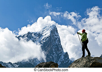 Hiking in Himalaya Mountains - Young woman hiking in...